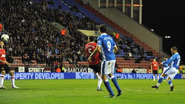 2011-12 Premier League Wigan Athletic's Shaun Maloney scores