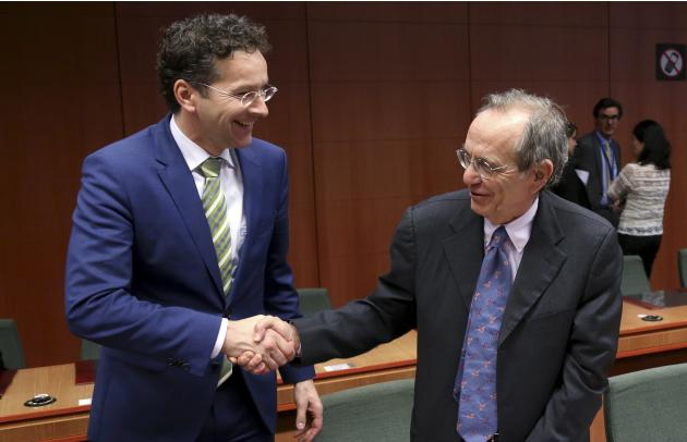 Dijsselbloem greets Padoan during an eurozone finance ministers meeting in Brussels