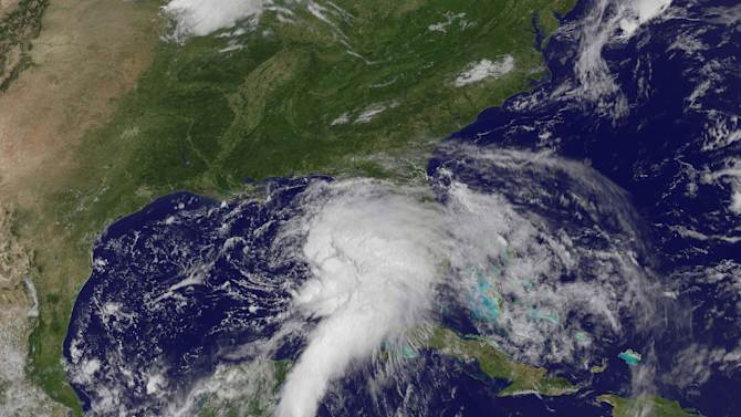 This NOAA satellite image taken Saturday, June 23, 2012, shows shower and thunderstorm activity developing around an area of low pressure spinning in the Gulf of Mexico. Tropical Storm Debby has formed in the Gulf of Mexico and forecasters say it will bring rain to the Gulf coast from southern Louisiana to the Florida Panhandle. (AP Photo/NOAA)