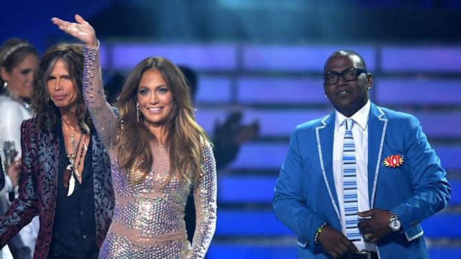 "FILE - In this May 23, 2012 file photo, from left, Steven Tyler, Jennifer Lopez and Randy Jackson appear onstage at the ""American Idol"" finale in Los Angeles. Jackson announced on Thursday, May 9, 2013, that he was departing the show after serving 12 seasons on the show's judging panel. Photo by John Shearer/Invision/AP, File)"