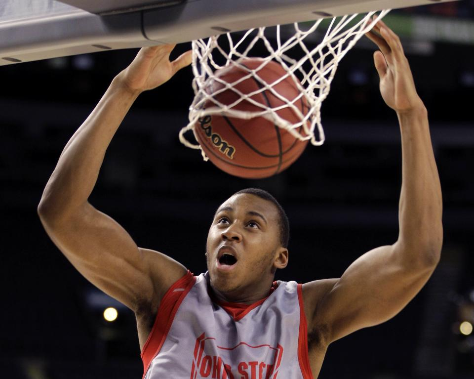 Ohio State center Trey McDonald (55) slam dunks during a practice session for the NCAA Final Four basketball tournament Friday, March 30, 2012, in New Orleans. Ohio State plays Kansas in a semifinal game on Saturday. (AP Photo/Mark Humphrey)