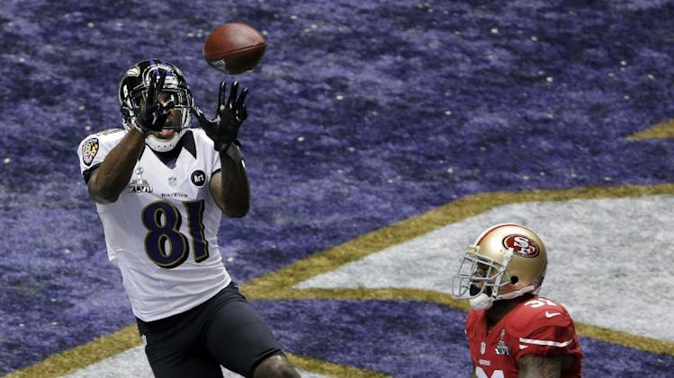 Baltimore Ravens wide receiver Anquan Boldin (81) catches a 13-yard pass for a touchdown as San Francisco 49ers safety Donte Whitner (31) and teammate NaVorro Bowman (53) trail the play during the first half of the NFL Super Bowl XLVII football game, Sunday, Feb. 3, 2013, in New Orleans. (AP Photo/Charlie Riedel)