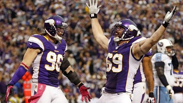 Minnesota Vikings defensive ends Jared Allen (69) and Brian Robison (96) celebrate after Allen sacks Tennessee Titans quarterback Matt Hasselbeck for an eleven-yard loss during the first half of their NFL football game in Minneapolis (Reuters)
