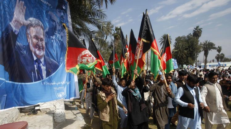 Supporters of Afghan presidential candidate Zalmai Rassoul arrive during a presidential election campaign rally in Jalalabad province