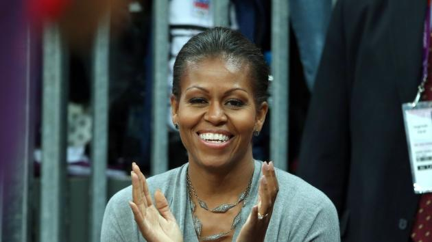 First Lady Michelle Obama watches the Men's Basketball game between the U.S. and France at the London 2012 Olympic Games in London on July 29, 2012 -- Getty Images