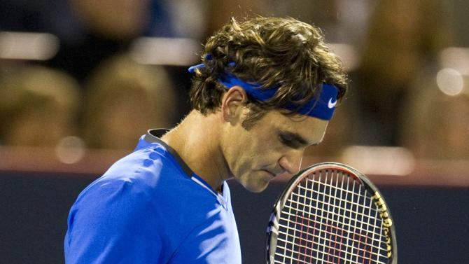 Roger Federer, from Switzerland, reacts during his match against Jo-Wilfried Tsonga, from France, during the Rogers Cup men's tennis tournament Thursday, Aug. 11, 2011, in Montreal. (AP Photo/The Canadian Press, Paul Chiasson)