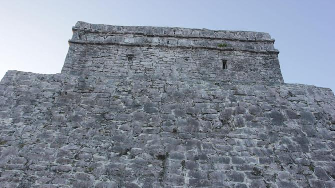 This Jan. 4, 2013, photograph, shows the castle at the Mayan ruins in Tulum, Mexico. Tulum may be best-known for its ancient Mayan ruins, which attract a steady stream of day-trippers, cruise passengers and tour buses. The complex of crumbling structures here is smaller and less impressive than some other Mayan sites like Chichen Itza, but its location atop seaside cliffs is one of the most scenic ruin sites on the Yucatan.  (AP Photo/Manuel Valdes)
