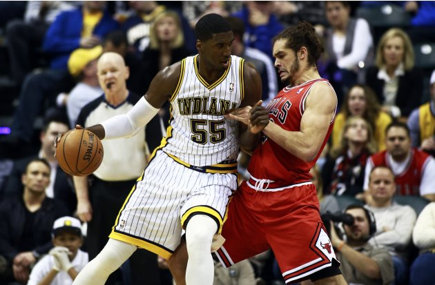 Indiana Pacers' Hibbert leans on Chicago Bulls' Noah as Hibbert moves to the basket during their NBA basketball game in Indianapolis