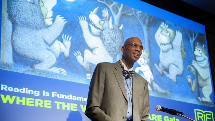"IMAGE DISTRIBUTED FOR READING IS FUNDAMENTAL - Kareem Abdul-Jabbar reads the classic children's book by Maurice Sencak ""Where the Wild Things Are"" during the Reading Is Fundamental ""Where the Wild Things Are"" Gala, Thursday May 9, 2013, at the Four Seasons Hotel in Washington. The nation's oldest children's literacy organization, RIF provided more than 4 million underserved children 10 million new books last year alone. (Kevin Wolf/AP Images for Reading Is Fundamental)"