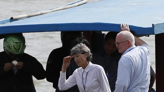 Australian lawyer McMahon and Hind, Australia's consul-general to Bali, return by ferry from the prison island of Nusakambangan, where upcoming executions are expected, in Cilacap