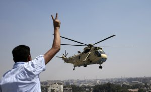 A man flashes a victory sign at an Egyptian military…