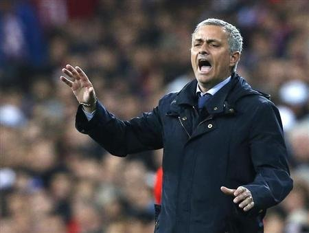 Real Madrid coach Jose Mourinho shouts to his players during their Spanish King's Cup final soccer match against Atletico de Madrid at Santiago Bernabeu stadium in Madrid
