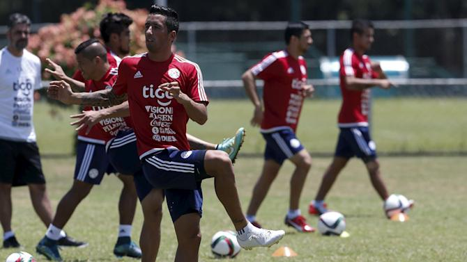 Paraguay's national soccer team player Lucas Barrios (C) takes part with teammates in a training session in Puerto Ordaz, Venezuela