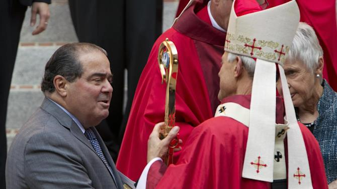 Cardinal Archbishop of Washington Donald Wuerl talks with Supreme Court Justice Antonin Scalia after the 60th annual Red Mass at the Cathedral of St. Matthew the Apostle in Washington Sunday Sept. 30, 2012. The Red Mass is traditionally held in Washington the day before the Supreme Court's new term opens. (AP Photo/Jose Luis Magana)
