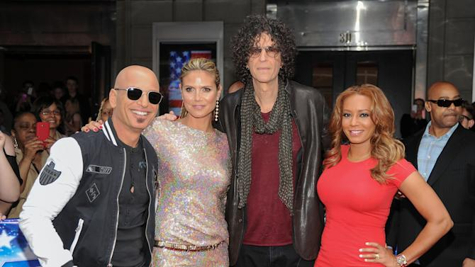 """FILE - This April 9, 2013 file photo shows season eight celebrity judges, from left, Howie Mandel, Heidi Klum, Howard Stern and Melanie """"Mel B."""" Brown arrive at the """"America's Got Talent"""" auditions  in New York. The new season of """"America's Got Talent"""" starts Tuesday at 9 p.m. EDT. (Photo by Evan Agostini/Invision/AP, file)"""