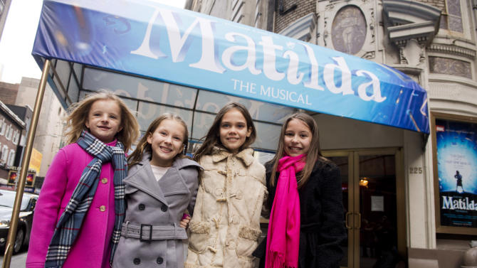 """Actresses, from left, Milly Shapiro, Sophia Gennusa, Oona Laurence and Bailey Ryon, who will share the title role in """"Matilda the Musical"""" on Broadway, pose for a portrait outside the Shubert Theatre, on Thursday, Nov. 15, 2012 in New York. (Photo by Charles Sykes/Invision/AP)"""