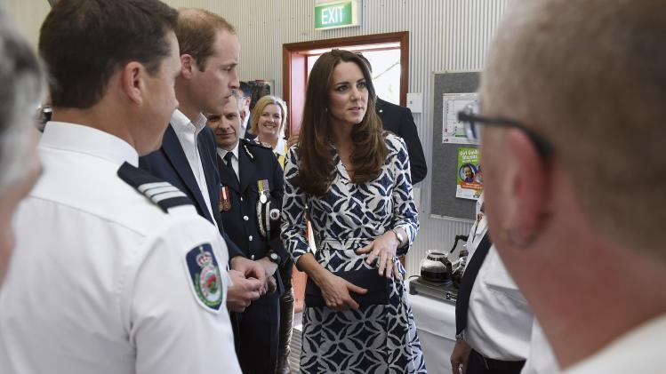 Catherine, the Duchess of Cambridge, and her husband, Britain's Prince William, talk with firefighters during a visit to the Blue Mountains suburb of Winmalee, that lost homes during bushfires last year, west of Sydney