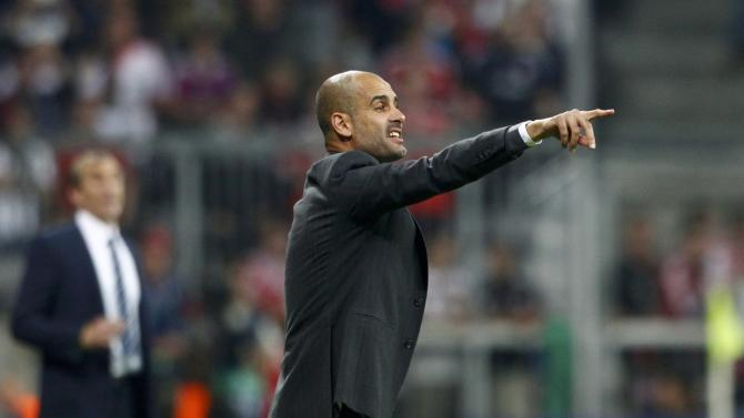 Bayern Munich's coach Guardiola shouts to players during Champions League soccer match against Manchester City in Munich