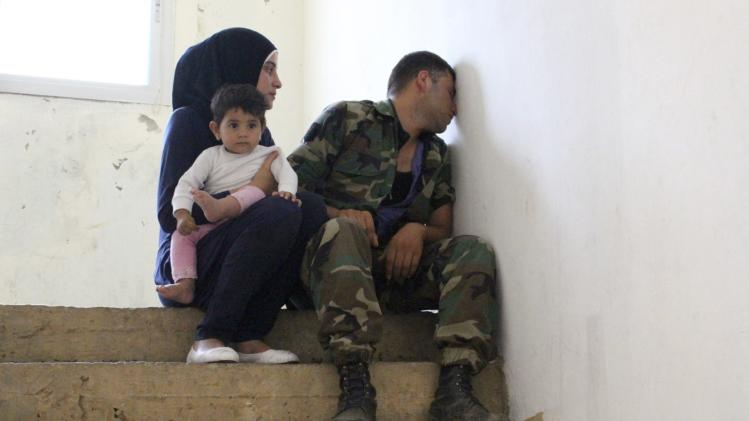 Relatives of Lebanese soldier Ali al-Sayyed, who was beheaded by Islamic State militants, mourn in the town of Fnideq