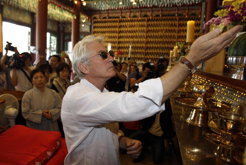 U.S. actor Richard Gere prays during his visit to the Korean Buddhism's Chogye temple in Seoul, South Korea, Tuesday, June 21, 2011. Gere is in South Korea for six days to promote his photo exhibition and tour Buddhist temples. (AP Photo/ Lee Jin-man, Pool)