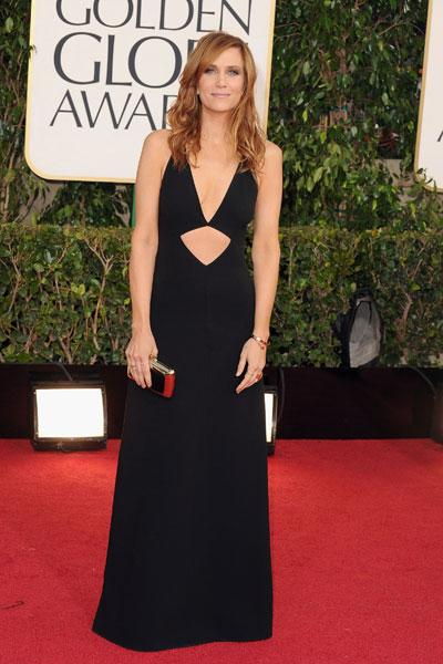 Kristen Wiig: Perhaps the 'Bridesmaids' star would look better if she wasn't slouching. Nevertheless, the star looks pretty great in a sexy little black dress with a low-cut neckline and a diamond cutout. (Photo by Steve Granitz/WireImage)