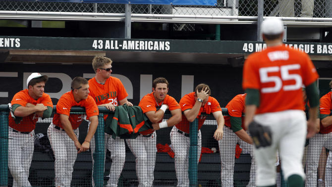 Miami players watch from the dugout as starting pitcher Steven Ewing (55) is relieved in the first inning during an NCAA college baseball tournament regional game against Missouri State, Saturday, June 2, 2012, in Coral Gables, Fla. Missouri State scored seven runs in the first inning. (AP Photo/Lynne Sladky)