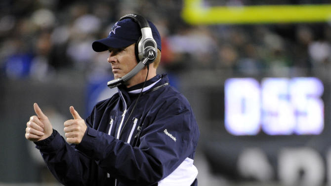 Dallas Cowboys interim head coach Jason Garrett reacts after a touchdown by tight end Jason Witten in the second half of an NFL football game against the Philadelphia Eagles, Sunday, Jan. 2, 2011, in Philadelphia. Dallas won 14-13. (AP Photo/Miles Kennedy)