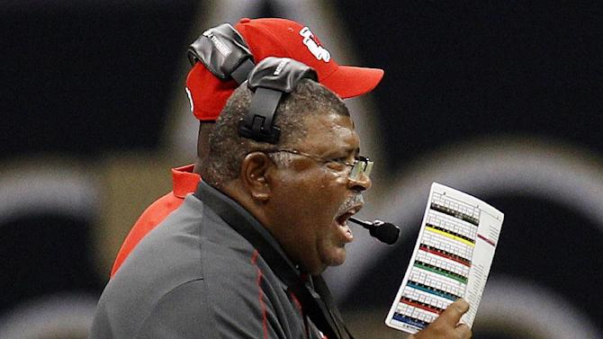 Kansas City Chiefs head coach Romeo Crennel calls out from the sideline in the first half of an NFL football game against the New Orleans Saints in New Orleans, Sunday, Sept. 23, 2012. (AP Photo/Bill Haber)
