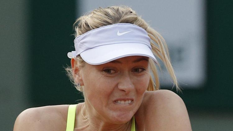 Russia's Maria Sharapova returns against Su-Wei Hsieh of Taipei in their first round match of the French Open tennis tournament, at Roland Garros stadium in Paris, Monday, May 27, 2013. (AP Photo/Michel Spingler)