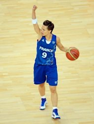 French guard Celine Dumerc is seen in action during the London 2012 Olympic Games women's semifinal basketball game bewteen Russia and France at the North Greenwich Arena in London. France won 81-64