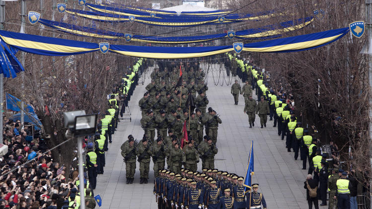 Kosovo Security Force honor guard leads the parade in the center of Pristina marking the 5th anniversary since Kosovo seceded from Serbia on Sunday, Feb. 17, 2013. Serbia rejects Kosovo's independence. (AP Photo/Visar Kryeziu)