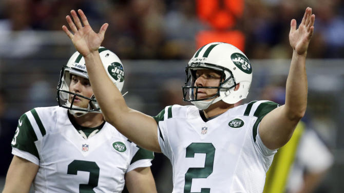 New York Jets kicker Nick Folk, right, celebrates alongside Robert Malone after making a 51-yard field goal during the second quarter of an NFL football game against the St. Louis Rams, Sunday, Nov. 18, 2012, in St. Louis. (AP Photo/Tom Gannam)