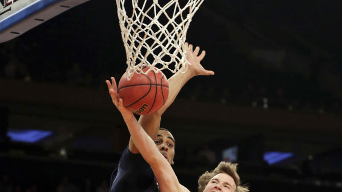 Baylor's Brady Heslip (5) drives past Brigham Young's Brandon Davies (0) during the first half of an NIT semifinal basketball game Tuesday, April 2, 2013, in New York. (AP Photo/Frank Franklin)