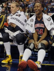 Indiana Fever's Katie Douglas and Tamika Catchings sit out the fourth quarter in a WNBA basketball game against the Connecticut Sun in Uncasville, Conn., Wednesday, Sept. 19, 2012. Connecticut won 73-67. (AP Photo/Jessica Hill)