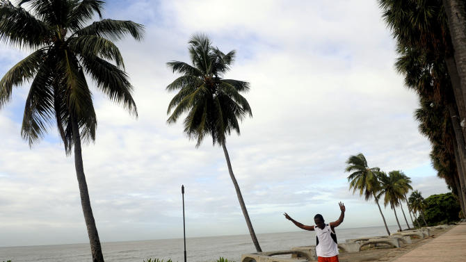 A man exercises on the Santo Domingo waterfront before the arrival of Tropical Storm Emily to the Dominican Republic, Wednesday Aug. 3, 2010. Forecasters say Emily will drop a huge amount of rain on the Dominican Republic and Haiti and is expected to reach the southwestern Dominican coast late Wednesday. (AP Photo/Manuel Diaz)