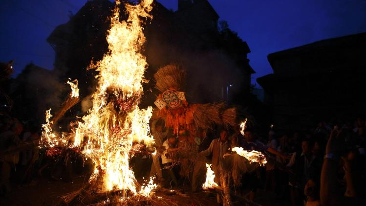 People carry an effigy of the demon Ghantakarna during the Ghantakarna festival in the ancient city of Bhaktapur