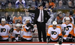 Philadelphia Flyers head coach Laviolette instructs his team against the Winnipeg Jets during their NHL hockey game in Winnipeg