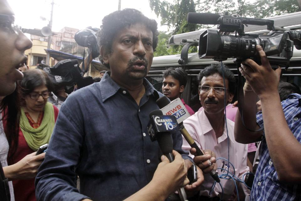 Indian film director Gautam Ghosh speaks as he arrives to pay homage to late director Rituparno Ghosh in Kolkata, India, Thursday, May 30, 2013.  Ghosh, whose work includes award-winning films in the Bengali language, died Thursday of cardiac arrest at age 49, news reports said. (AP Photo/Bikas Das)
