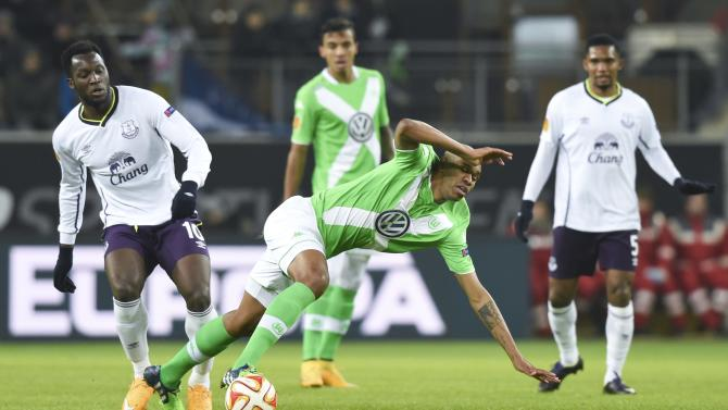 Wolfsburg's Naldo falls as he fights for the ball with Everton's Lukaku during their Europa League Group H soccer match in Wolfsburg