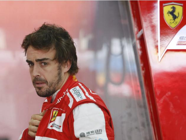 Ferrari Formula One driver Alonso looks on during the third practice session of the Korean F1 Grand Prix in Yeongam