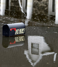 A mailbox peeks above floodwaters from Hurricane Isaac in Braithwaite, La., Sunday, Sept. 2, 2012. More than 200,000 people across Louisiana still didn&#39;t have any power five days after Hurricane Isaac ravaged the state. Thousands of evacuees remained at shelters or bunked with friends or relatives. (AP Photo/Gerald Herbert)