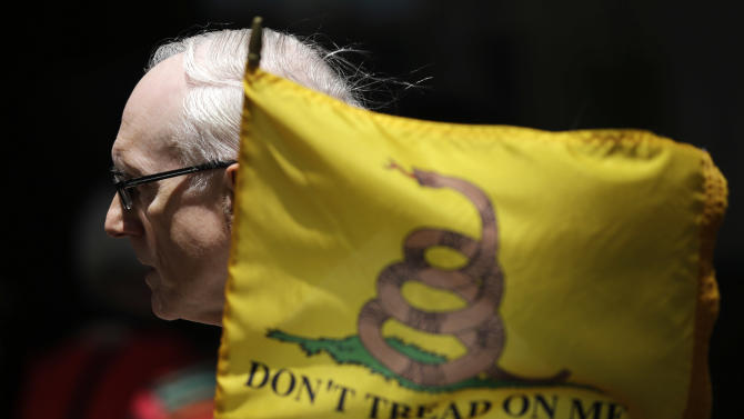 Bernie Brunner, of Springfield, Pa., holds a flag during a tea party rally protesting extra IRS scrutiny of their groups, Tuesday, May 21, 2013, in Philadelphia.  The Internal Revenue Service gave extra scrutiny to tea party and other conservative groups seeking tax-exempt status.  (AP Photo/Matt Slocum)