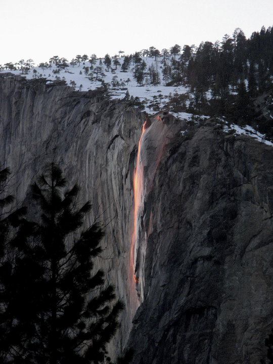 In this undated handout photo provided by the Scott Gediman of the Yosemite National Park Service, the firefall from Glacier Point is shown in Yosemite. A window of time just opened in Yosemite Nation