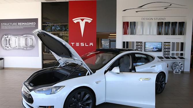 A Tesla Model S car is displayed at a showroom in Palo Alto, California, on November 5, 2013