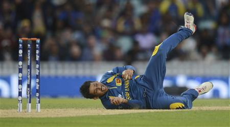 Sri Lanka's Tillakaratne celebrates after catching Australia's McKay as his team qualify for the semi final in the ICC Champions Trophy group A match at The Oval cricket ground, London
