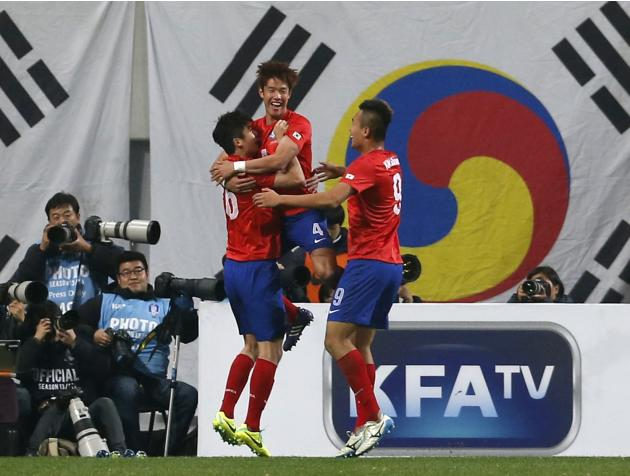 South Korea's Hong celebrates with his teammates after scoring a goal against Switzerland during their friendly soccer match at the Seoul World Cup stadium in Seoul