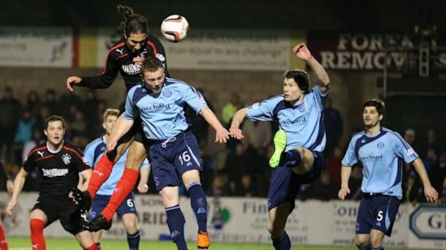 Bilel Mohsni heads in Rangers' opening goal at Station Park