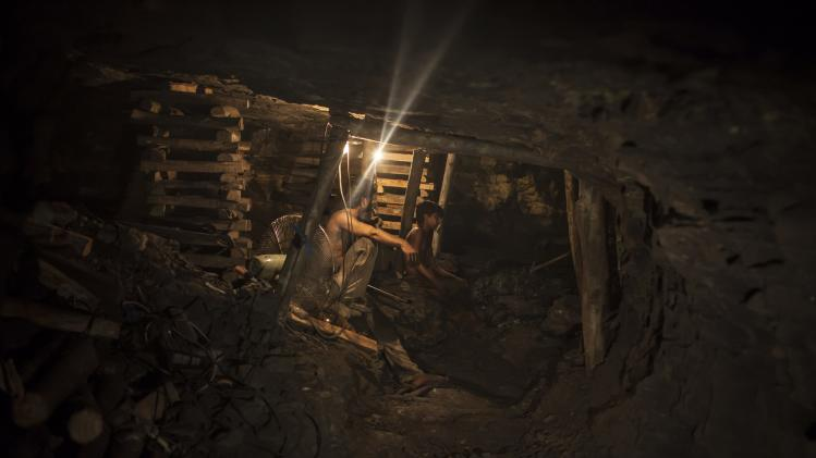 Samiullah sits at the coal face to observe the process of coal mining, underground in Choa Saidan Shah, Punjab province
