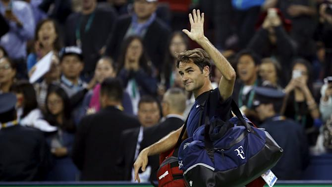 Roger Federer of Switzerland leaves the court after losing to Albert Ramos-Vinolas of Spain during their men's singles match at the Shanghai Masters tennis tournament in Shanghai
