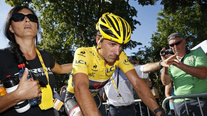 Race leader and yellow jersey holder Trek Factory rider Fabian Cancellara of Switzerland reacts at the end of the third stage of the 102nd Tour de France cycling race from Anvers to Huy